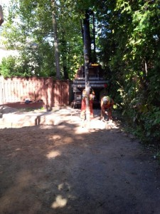 Difficult to see but this is the vacumn truck digging for the utilites on the laneway